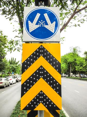 split road: arrow split way symbol with LED light on road.