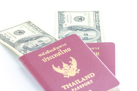 Two passports Thailand with American dollars money. photo