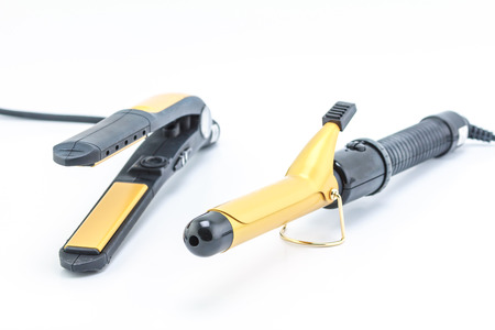 curling irons: The device for hair styling isolated on a white background. Stock Photo