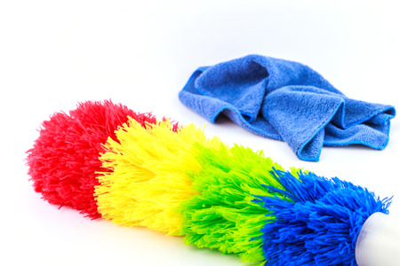 Colorful duster with plastic handle isolated on white background. photo