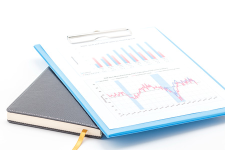Concept of business graph on clipboard and notebook.