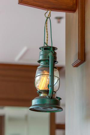 Lantern hanging on hook in restaurants.