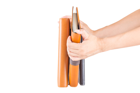 Hand hold a brown and black leather diary books  isolated on white background. Standard-Bild