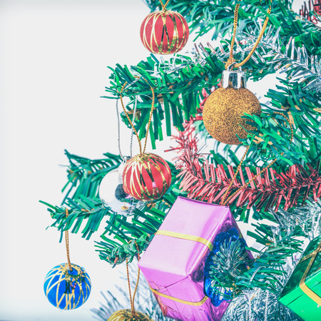 Christmas tree and gifts on with pastels filter.
