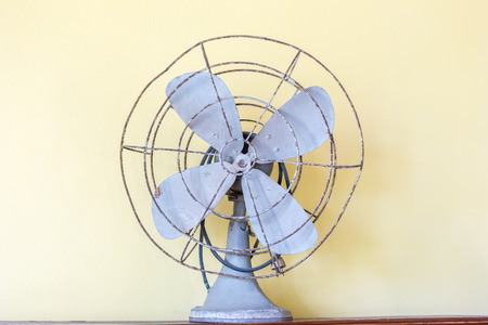 Old fan vintage style on yellow wall background.