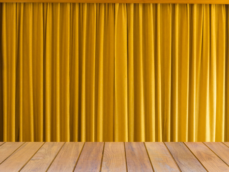 Yellow curtain with wooden table for use show product background.