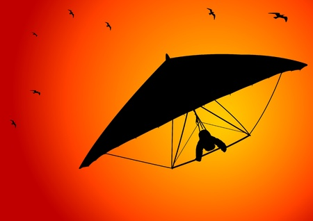 adventurer: A Vector illustration of silhouetted figure of a man gliding in the sky