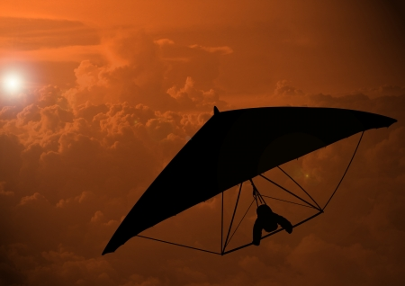 glider: A Stock image of a man glide in the sky Stock Photo