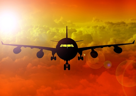 yellowish: A Stock Image Illustration of an Airplane fly at sunset