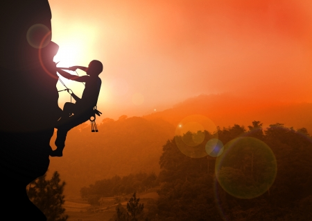 conquer: Stock illustration of Mountain Climbing at Sunset