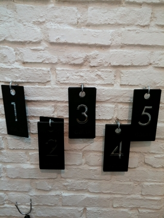 Numbers hang on White brick pattern Stock Photo