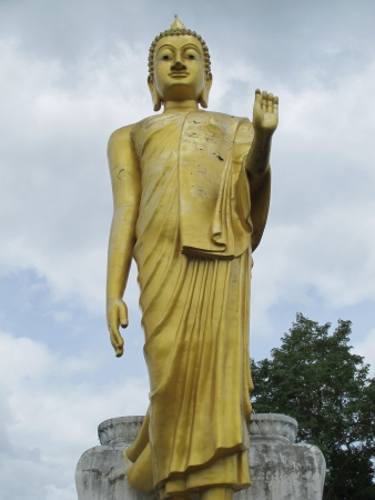 Statue of Buddha with cloudy sky