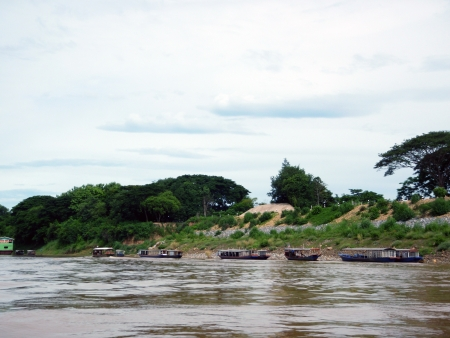 Ferryboats anchor Mekong River Bank