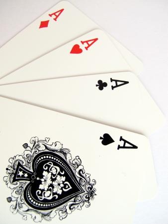 as de picas: cuatro ases jugando a las cartas Foto de archivo