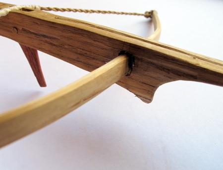 crossbow: wooden crossbow on white background