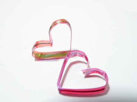 two ribbon hearts in white background