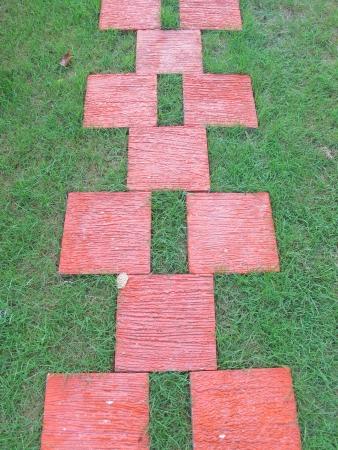 pathway of red stone bricks
