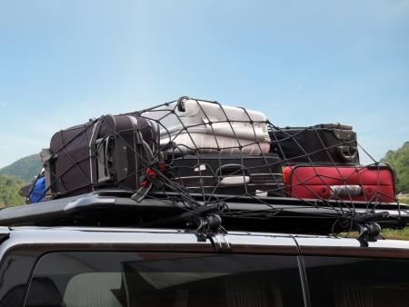 luggages over the car roof for a trip photo