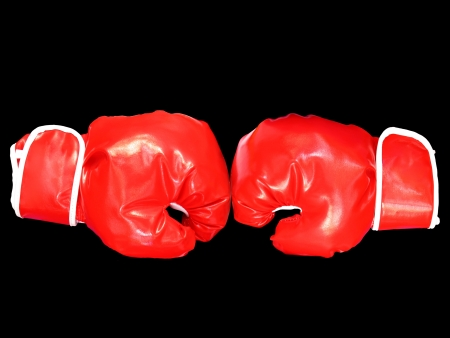 Red boxing gloves on black background Stock Photo - 18221655