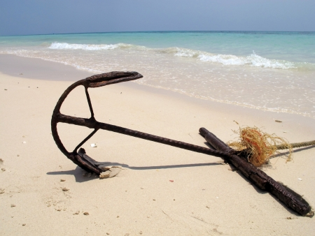 An anchor on the sand beach  photo