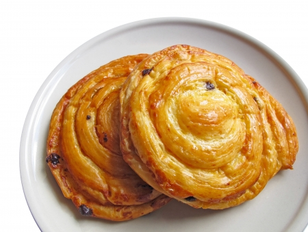two fresh danish pastry on plate  photo