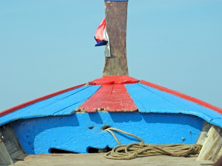 prow: prow of long tail boat in blue sky Stock Photo