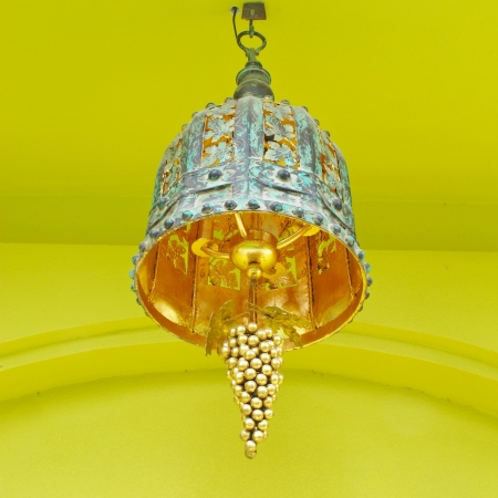 closeup of ornate lamp with yellow background photo