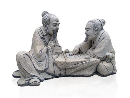 statue of two chiness playing game go                                 photo