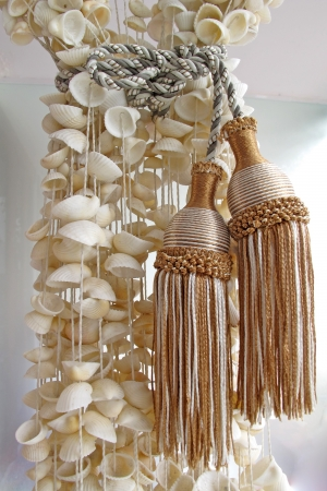 Curtains made of Seashells holding by tassel  photo