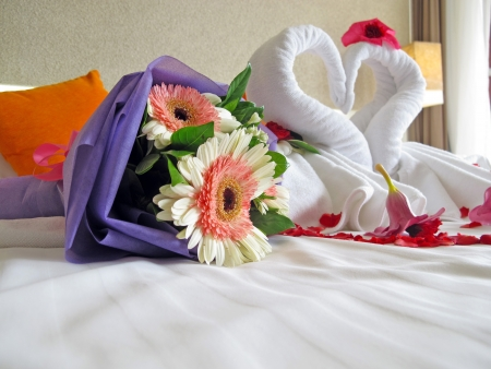 bedsheets: Two swans made of towels and Bridal bouquets in hotel