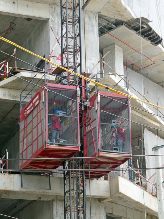 BANGKOK - AUGUST 16  Workers are using elevator in construction site at Siam Square area on August 16, 2013 in Bangkok, Thailand