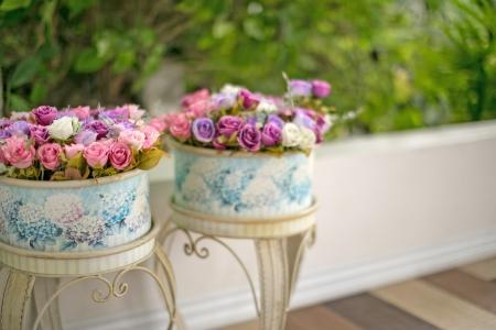 decorated roses in flowerpot at veranda. photo