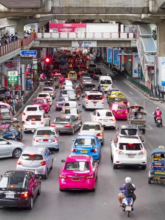 BANGKOK - AUGUST 13: Traffic jam on the road below the BTS Skytrain at Siam station, Bangkok central shopping area on August 13, 2013 in Bangkok, Thailand. Editorial
