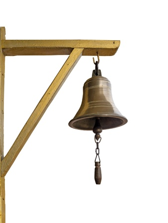 Bronze bell hanging on triangle wood isolated on white  photo