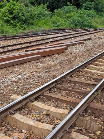 Old railroad tracks and material for repair near by it  Imagens