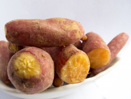 Heap of cooked sweet potatoes on plate
