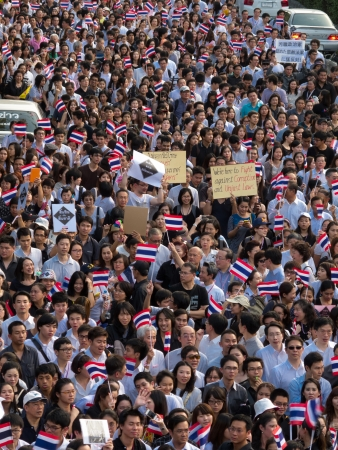 demonstrator: BANGKOK - NOVEMBER 5  Current students and alumni of Chulalongkorn University march from front of university to Bangkok art and culture centre for against the amnesty law that negate the guilty of politicians in many case on November 5, 2013 in Bangkok, T Editorial