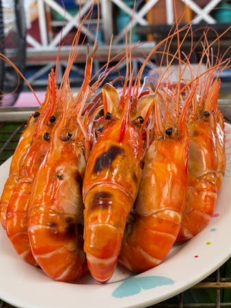 Grilled crawfishes on white plate  photo