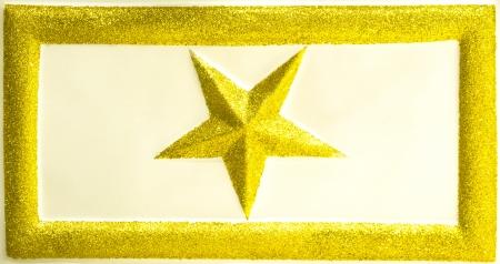 glitzy: Golden glittering star in rectangle frame  Stock Photo