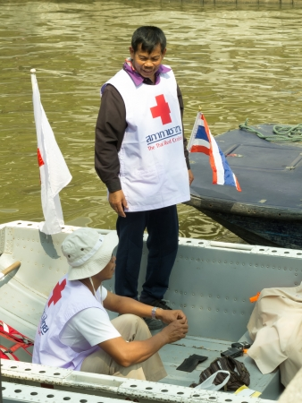 BANGKOK - DECEMBER 9  Red Cross volunteers ready to assist waterway during anti-government protestation nearby Royal Thai Government House on December 9, 2013 in Bangkok, Thailand