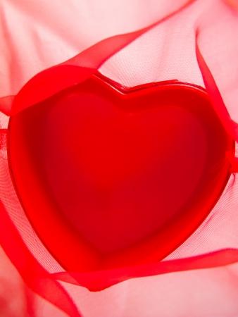 gauzy: Red heart on red gauzy textile  Stock Photo