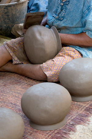 Ancient process of making clay pot in Thailand.