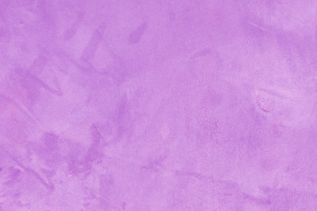 Old cement wall texture in violet color. Stock Photo