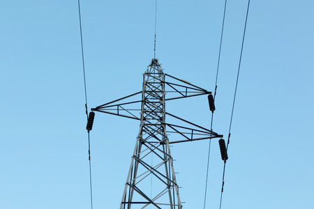 high voltage post with blue sky background. Stock Photo