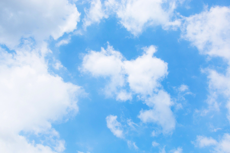 White soft clouds in the blue sky. Stock Photo