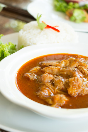 Red spicy curry with chicken meat (Massaman Curry Chicken). Stock Photo