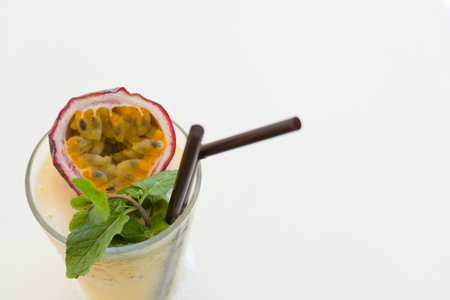 Refreshing with a glass of passion fruit smoothie on white background. Stock Photo