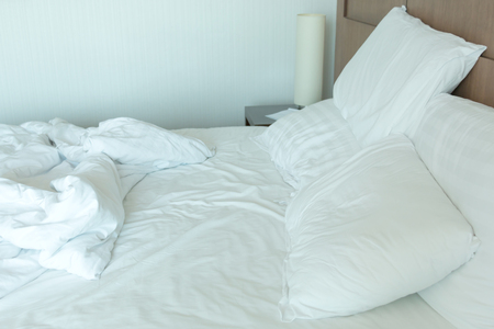 Messy bedding sheets and pillows after night sleep. Stock Photo
