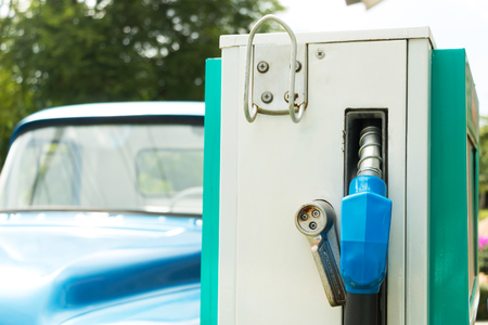 cami�n de reparto: Pick-up truck at gas station waiting for refuel during travelling.