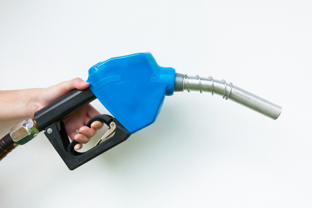 A fuel nozzle in hand on a white background.